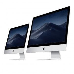 Ordinateur fixe Apple iMac 21.5 pouces. Couleur Gris. Deux écrans vue de 3/4.