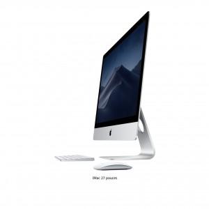Ordinateur fixe Apple iMac 21.5 pouces. Couleur Gris. Vue de 3/4, écran allumé. Souris et clavier.